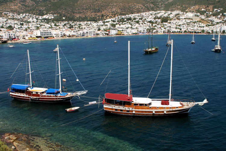 "Sailing yachts (Gület) in Bodrum, Aegean Sea, Turkey. A Gület is a traditional designed two-masted wooden sailing boat, often used for trips called ""Blue Cruise"" along the coast of Aegean Sea and Mediterranean Sea. Important harbours for this kind of sailing yachts in Turkey are Bodrum and Marmaris. Bodrum Yacht Yachting Sailing Sailing Boat Gulet Transportation Boat Shore Tourist Destination Turkey Mediterranean  Aegean Aegean Sea"
