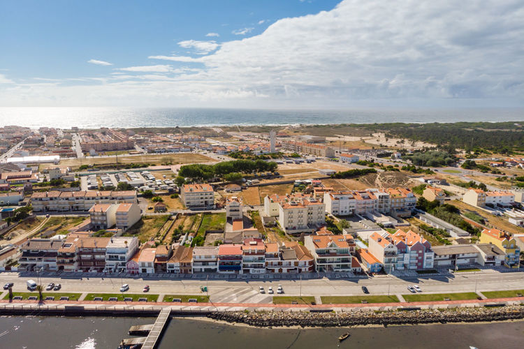 Aerial view of Torreira, Portugal, and the Atlantic ocean Aveiro Portugal Ria Travel Aerial View Architecture Blue Sky Building Exterior City Environment High Angle View Nature No People Outdoors Torreira Tourism Town