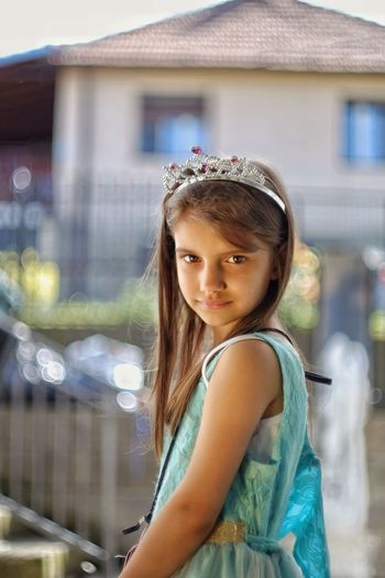 Side view portrait of innocent girl wearing tiara