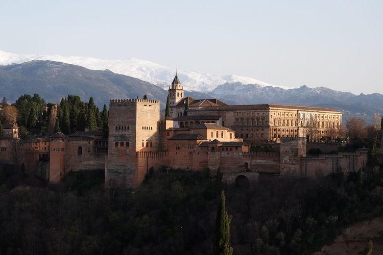 Castle against mountain range