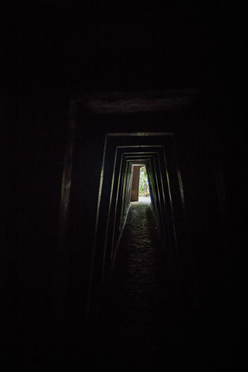 Vietnam 2018 VietCong Arcade Architecture Bombs Bombshell Building Built Structure Copy Space Corridor Dark Diminishing Perspective Direction Door Entrance Illuminated In A Row Indoors  Light At The End Of The Tunnel Night No People Outdoors The Past The Way Forward Tunel Vietnamwar War