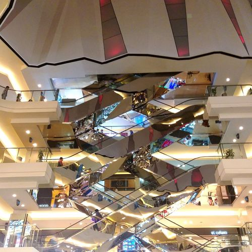 Low angle view of illuminated pendant lights hanging in shopping mall