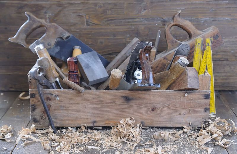 High angle view of tools on wood