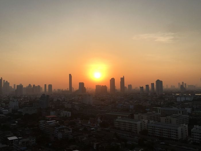 Sunrise #sky Bangkok Thailand Bangkok Thailand EyeEm Selects Golden Light #Sunrise Goldensky #Nature  #beautifulnature Building Exterior City Sky Built Structure Architecture Cityscape Building No People Skyscraper Sun Outdoors Nature Orange Color