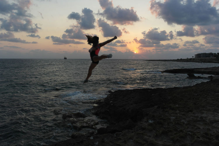 Chemistart Dramatic Sky Rhythmic Gymnastics Woman Cloud - Sky Horizon Over Water Jumping One Person Pafos Real People Sea Silhouette Sky Sunset Water Be. Ready. Perspectives On Nature Rethink Things