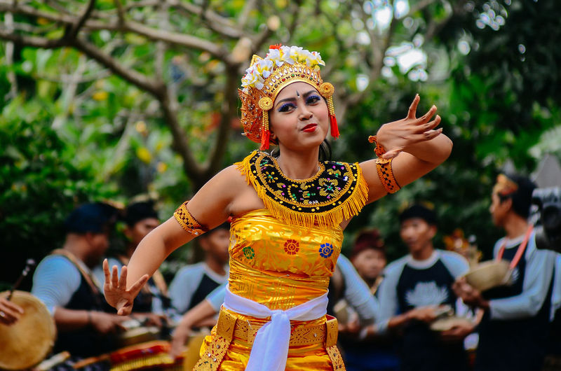 Woman in balinese traditional clothing dancing