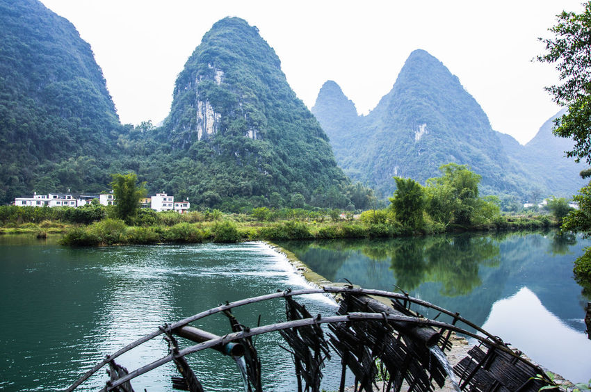 Beautiful Yulong River scenery China Beauty Guilin, Guangxi, China Natural Beauty Peace And Quiet Yangshuo, Yulong River Beauty In Nature Countryside Day Karst Mountain Landscape Nature No People Outdoors Picturesque Reflections In The Water Riverscape Scenery Scenics Sky Travel Destinations Tree Trees And Sky Water Yangshuo