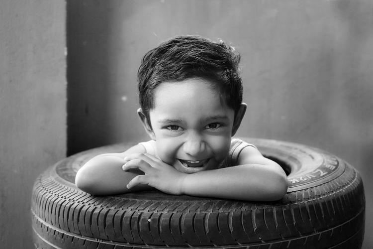 Portrait of cute boy against wall