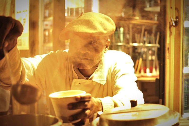 Close-up of man drinking coffee at restaurant