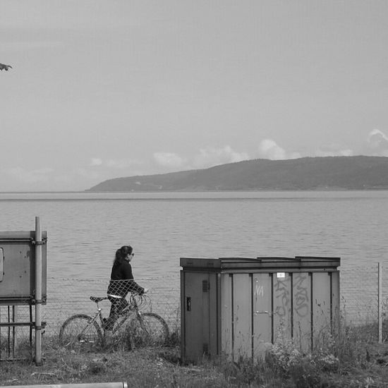 Biking by the lake. People Watching Streetphotography Blackandwhite Landscape