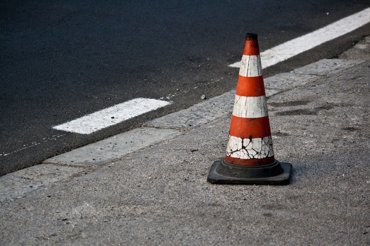 Skittle (road cone) Asphalt Close-up Danger Day Drive EyeEm Best Edits EyeEm Best Shots EyeEm Gallery Incidental People No People Outdoors Red Red And White Road Road Road Cone Road Construction Road Sign Safety Skittle Street The Week On EyeEem Transportation