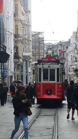 Garibim Ne bir güzel var Avutacak gönlümü Bu şehirde, Ne de tanıdık bir çehre; Bir tren sesi Duymaya göreyim İki gözüm iki çeşme... (Orhan Veli Kanık) Showcase April Istanbul City İstiklal Street - İstanbul/TURKEY Urban Landscape EyeEm Gallery Eye4photography  Silhouette Tram Tramvay Streetphotography Street Photography Street Street Life Ineedamiracleformylostsoul Eternity And A Day Capture The Moment Untold Stories Feeling Landscape Urbanphotography Urban Photography On Way