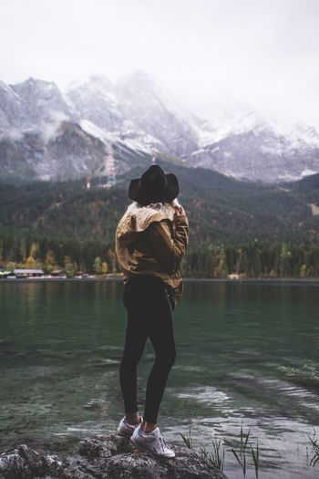 Mountain Lake Rear View Nature Snow Mountain Range Full Length Beauty In Nature Water Outdoors Tranquility Scenics Standing One Person Real People Day Landscape Sky Tree Adult Girl Fitness