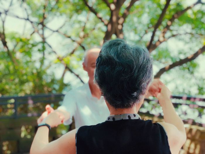 Couple Dancing Against Trees