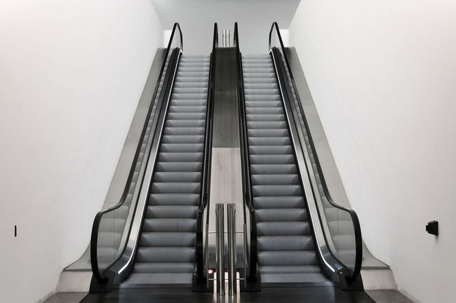 escalator in Barcelona ©alexander h. schulz Abstract Architecture Built Structure Design Escalator Horizontal Indoors  Interior Low Angle View Minimalism Museum No People Public Rolltreppe Silver  Steps Steps And Stairs Transportation Vertical Wall Way Up White