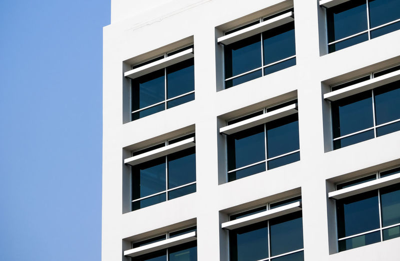 Window Building Exterior Built Structure Architecture Building No People Day Modern Low Angle View Residential District Outdoors Sunlight Nature Sky Glass - Material White Color Pattern Blue Full Frame Backgrounds Apartment