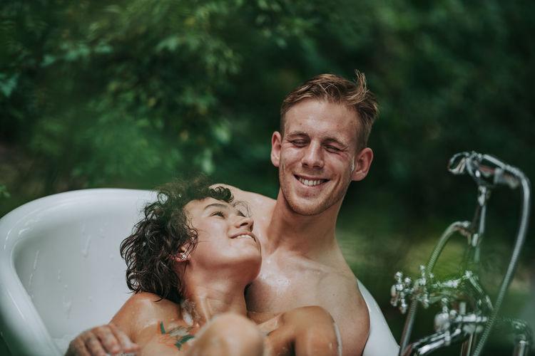 Portrait of shirtless man smiling