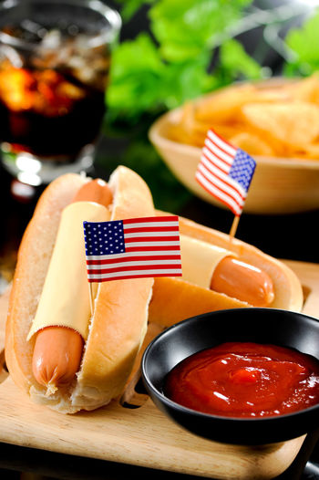 American Flag Fast Food HotDog American Food Bread Flag Focus On Foreground Food Food And Drink Freshness Junk Food Meat Patriotism Plate Ready-to-eat Red Snack Table Tomato Sauce