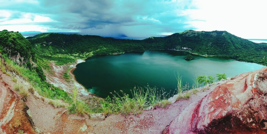 Crater of the world's smallest active volcano, Taal Volcano. first eyeem photo Mountains Mountain View Red Lava Crater Lake Opening Small Volcano World Smallest Volcano Active Volcano Lost In The Landscape EyeEmNewHere Smartphone Photography Close-up Day Nature Beauty In Nature Second Acts Perspectives On Nature EyeEm Phillipines An Eye For Travel Water Tranquil Scene Sky Scenics Cloud - Sky Tranquility No People Outdoors Tree Mountain
