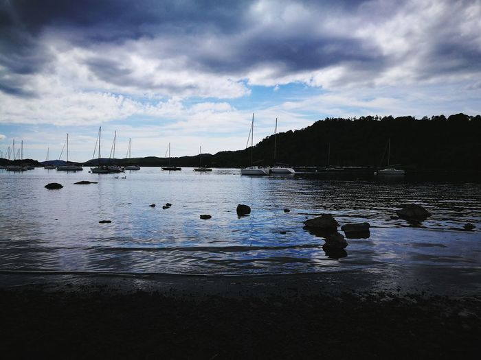 At the lake Lake Water Waves Reflection Clouds Boats Stalling Boats Yacht Blue May Windermere Lake High Contrast Dark Bright Sun Behind The Clouds Holiday Huawei p9