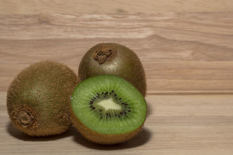 Kiwifruit Close-up Day Food Food And Drink Freshness Fruit Green Color Healthy Eating Indoors  Kiwi - Fruit No People SLICE Table Wood - Material