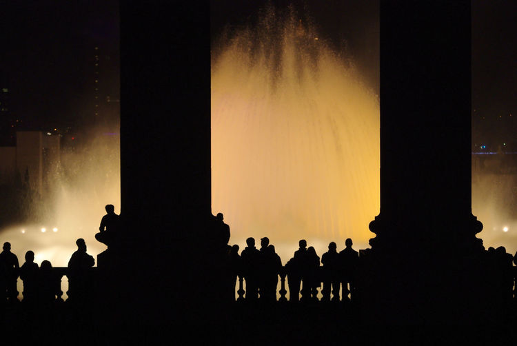 Audience Crowd Fountain Illuminated Magic Fountain Magic Fountain Of Montjuïc Night People Performance Show Silhouette Yellow The Street Photographer - 2017 EyeEm Awards EyeEmNewHere Neon Life Investing In Quality Of Life Your Ticket To Europe Mix Yourself A Good Time Your Ticket To Europe Paint The Town Yellow