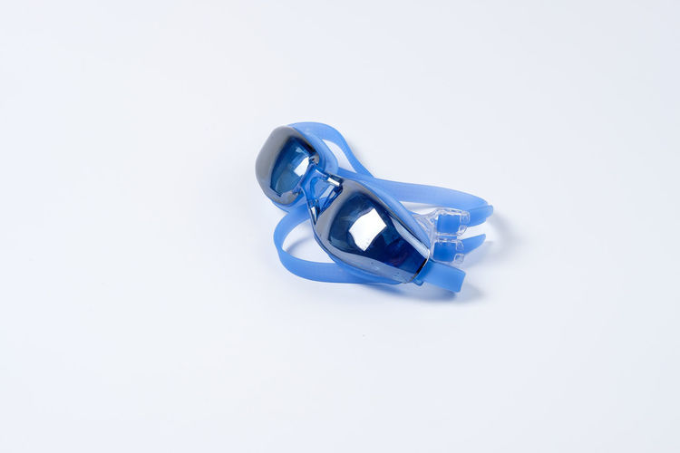 Blue Clean Equipment Glossy Goggle Goggles Rubber Swim Swimming Swimming Goggle White White Background Studio Shot Copy Space Cut Out Indoors  Still Life Metal Close-up Single Object No People High Angle View Two Objects Silver Colored Office Supply Reflection Shape Jewelry Toy