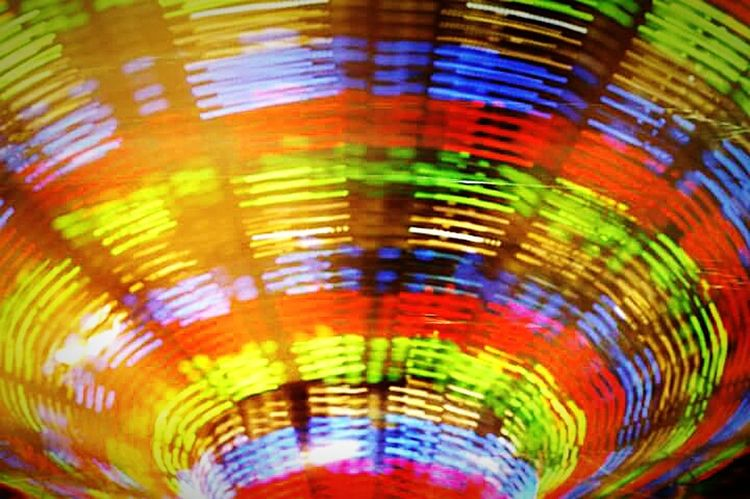 This is how my head spins... NikonFM2 Film 35mmfilmphotography EyeEmNewHere 35mm Film 35mm Double Exposure Multi Colored Backgrounds Pattern Amusement Park Abstract Full Frame
