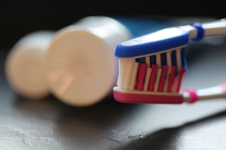 Close-up Indoors  No People White Color Kitchen Utensil Food And Drink Food Healthcare And Medicine Toothbrush Selective Focus Still Life Table Red Hygiene Routine Ball Body Care Equipment Sport