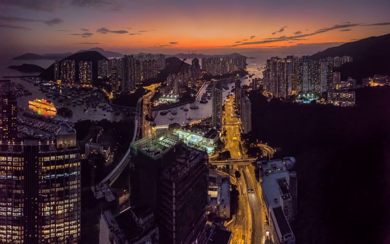 Panoramic Aerial View of a Stunning Sunset over Aberdeen And Ap Lei Chau district of Hong Kong Aberdeen Architecture Stunning Travel Above Aerial Architecture Boats Building Exterior Built Structure City Cityscape Illuminated Modern Outdoors Sky Skyscraper Sunset Tower Urban Skyline