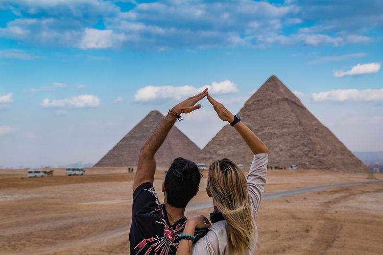 Sky Nature Day Outdoors Egypt Cairo Pyramids Giza Travel Trip Destination Ancient Structure Civilisation Old Pharaoh Real People Two People Cloud - Sky Land Women Togetherness Architecture Couple - Relationship Men Love Leisure Activity Bonding Moments Of Happiness It's About The Journey 2018 In One Photograph