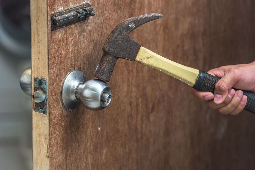 Thief with of hammer in the hand to open a door Close-up Day Holding Human Body Part Human Hand Men Metal One Person Outdoors People Real People Wood - Material