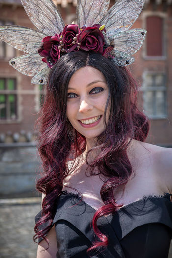 Portrait of smiling woman in costume standing outdoors