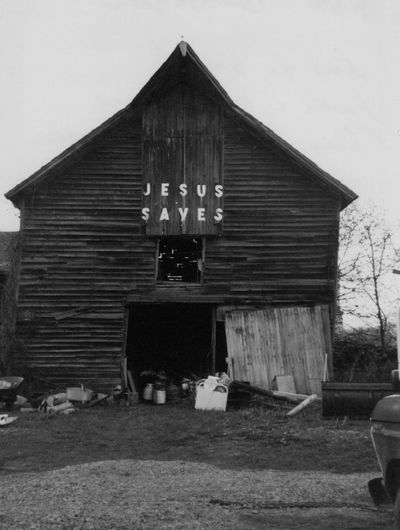 Lots of stuff Jesus Barn Architecture Broken Barn Door Building Exterior Built Structure Collectable Items For Sale Old Barn Saves Everything