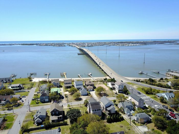 Morehead City Bridge to Atlantic Beach Atlantic Beach NC Drone  Morehead City NC OBX Aerial View Architecture Bridge Bridge - Man Made Structure Building Exterior Built Structure Clear Sky Day High Angle View Horizon Over Water Nature Outdoors Sea Water