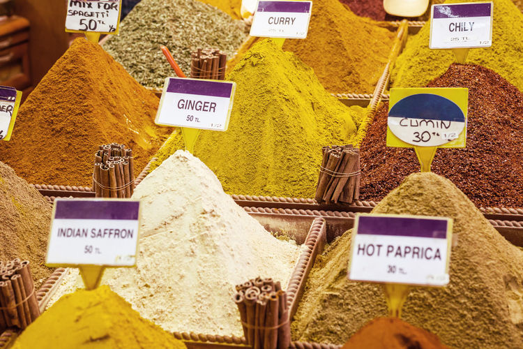 Close-Up Of Various Spices With Tags At Market Stall In Spice Bazaar