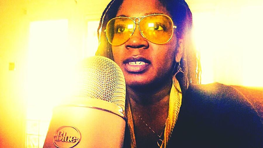 Radio Talk Show woman microphone yellow shades locs beight natural light Young Adult Indoors  Lifestyles Beauty Casual Clothing Enjoying Life
