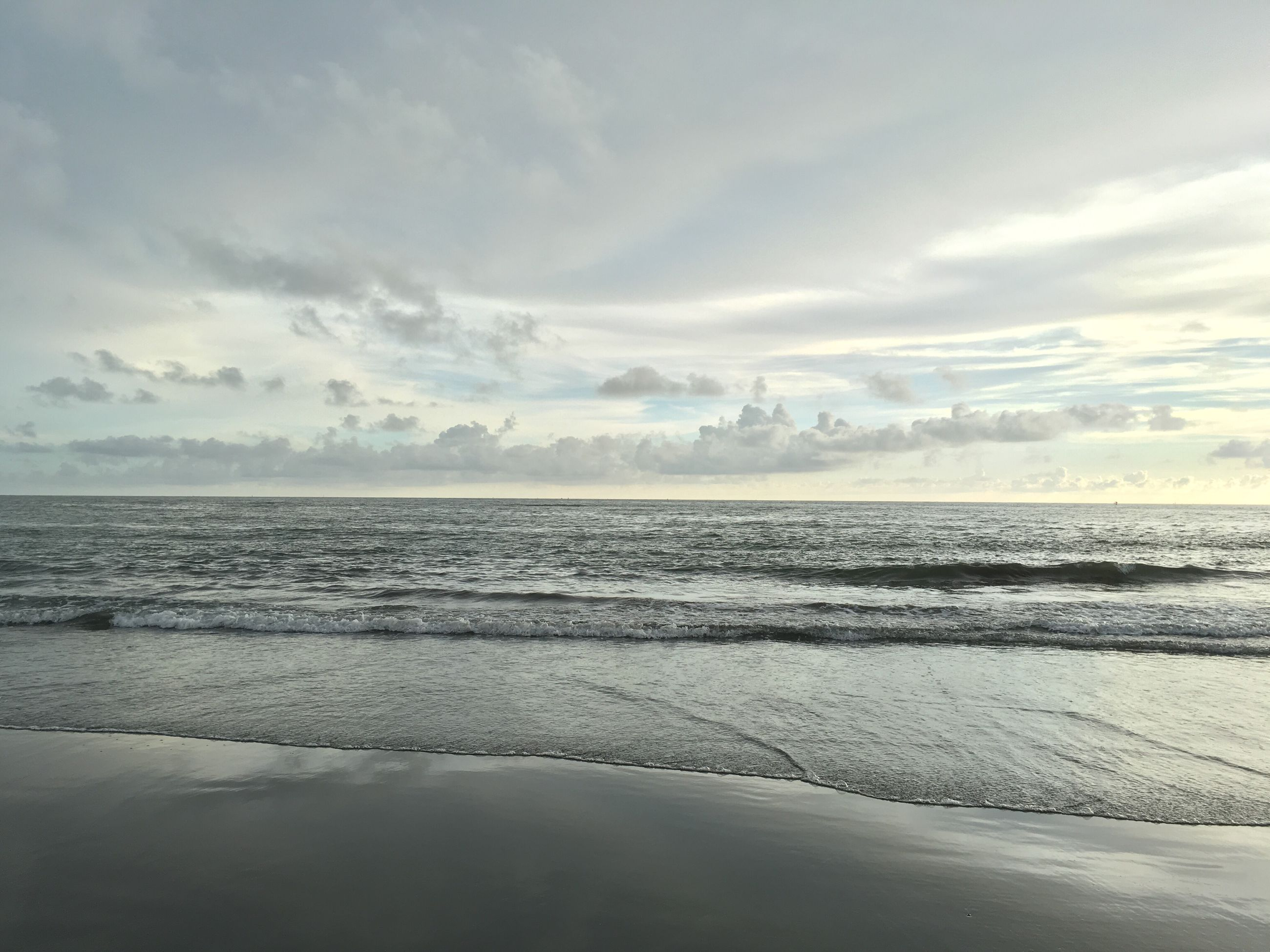 sea, water, beach, tranquil scene, horizon over water, tranquility, sky, scenics, beauty in nature, shore, sand, nature, cloud - sky, idyllic, wave, cloud, calm, outdoors, remote, reflection
