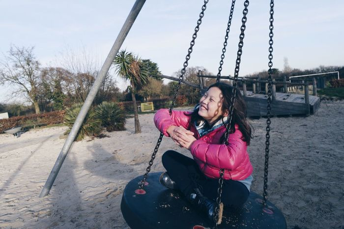 My sister on a swing Lifestyles Young Adult Sitting Swing Leisure Activity Young Women One Person Sky Outdoors Playground Fun Smile Laughter Park EyeEmNewHere