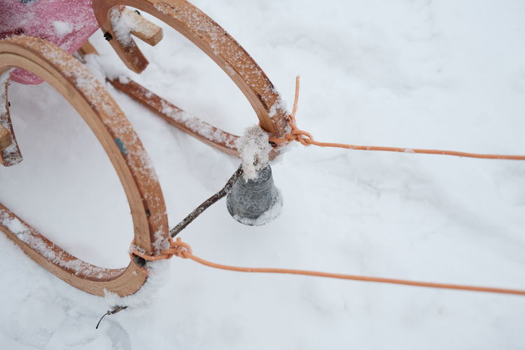 Close-up of frozen rope hanging on snow