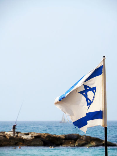 Day Fisherman Fishing Flag Horizon Over Water Israel Outdoors Sea Water