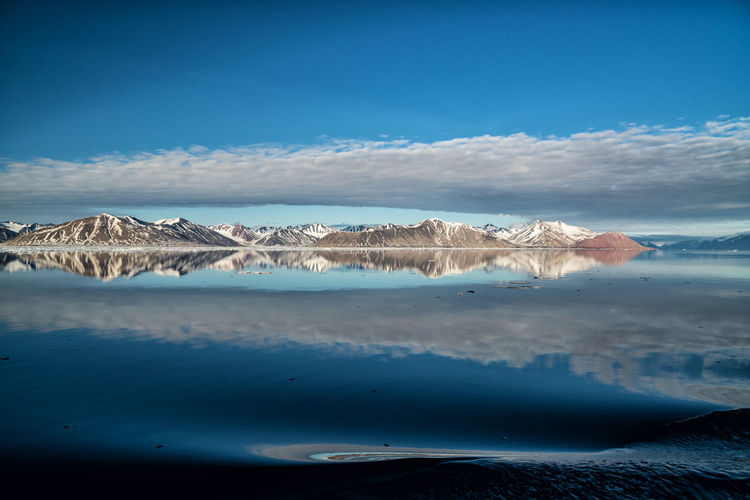 Woodfjord Water Scenics - Nature Sky Beauty In Nature Tranquil Scene Sea Tranquility Blue Cloud - Sky No People Day Mountain Nature Non-urban Scene Land Waterfront Idyllic Beach Lagoon Spitsbergen Svalbard  Arctic