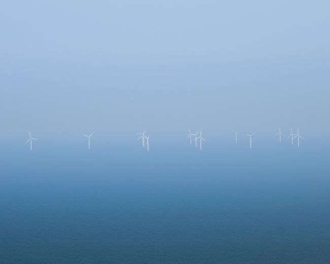 Anthropogenesis Minimal Blue Renewable Energy Windturbines Ocean No People Nature Water Copy Space Blue Environment Fuel And Power Generation Environmental Conservation Tranquility Outdoors Sea
