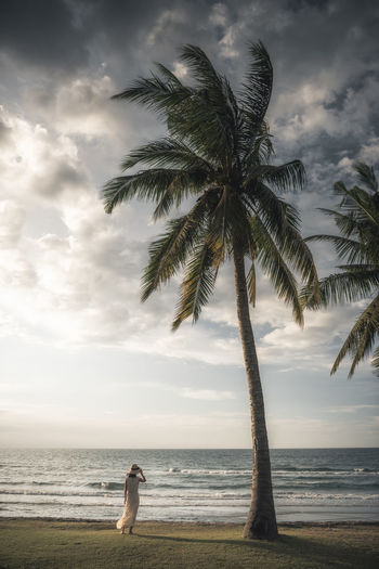 We Forgot the Time Colors Sky And Clouds Tranquility Travel Beach Beauty In Nature Beauty In Nature Cloud - Sky Horizon Over Water Landscape Leisure Activity Light And Shadow Nature Ocean One Person Outdoors Palm Tree Sand Scenics Sea Sky Travel Destinations Tree Water Wilderness