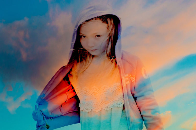 Double exposure of girl and sky