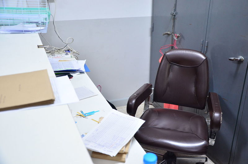 Empty chair by desk at office