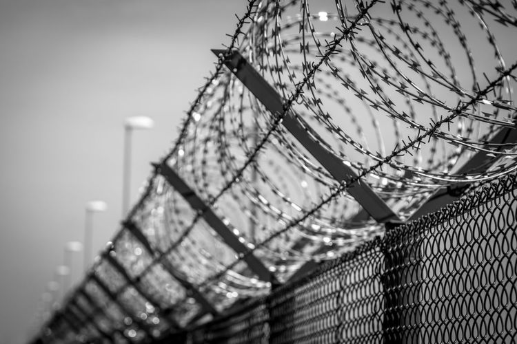 Jailhouse Jail Krull&Krull Images Black & White Black And White Protected Area Protected Protection Fence Barrier Boundary No People Metal Safety Barbed Wire Security Close-up Protection Architecture Built Structure Selective Focus Wire Low Angle View Razor Wire Building Exterior #FREIHEITBERLIN