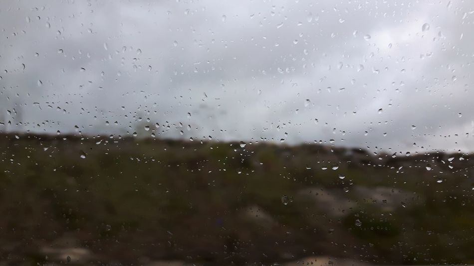 SARDINIA, ITALY. MAY 1, 2017. Spring rainy day near Sassari, Sardinia, Italy. Rain Rainy Dark Day Rainy Day Spring Autumn Winter Sardinia Sardegna Italy  Sardinia Sardegna Sassari Droplets Drop Window Wet Indoors  No People Backgrounds Weather Water RainDrop Nature Day Sky