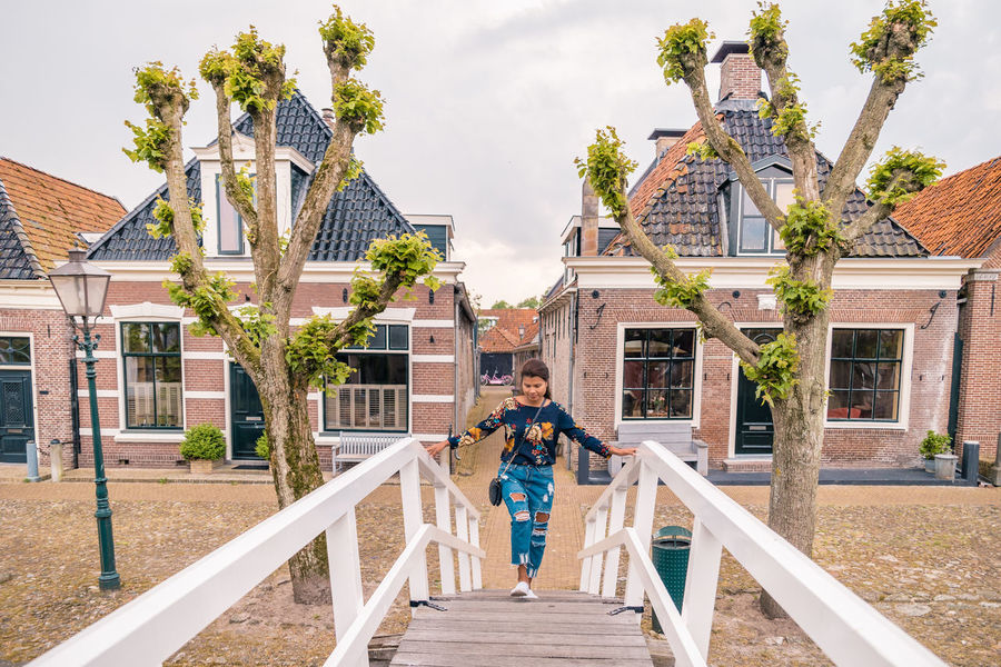 Netherlands Architecture Building Building Exterior Built Structure Child Day Dutch Freisland Friesland Town Full Length House Leisure Activity Lifestyles Men Nature Outdoors People Real People Rear View Sky Sloterdijk Togetherness Town Tree Two People Women