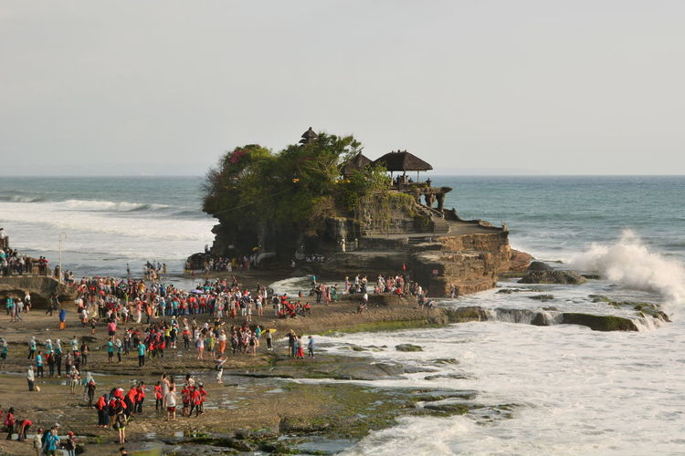 Pura Tanah Lot. Bali. Indonesia Tanah Lot Tanah Lot Temple Pura Tanah Lot Bali Bali, Indonesia Balinese INDONESIA Southeastasia Southeast Asia Asian  Place Of Worship Hinduism Hindu Temple Water Sea Scenics - Nature Beauty In Nature Horizon Over Water Real People Large Group Of People Horizon Outdoors Wave Nature Crowd Group Of People Beach